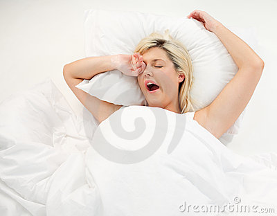 Girl yawning in bed after sleeping