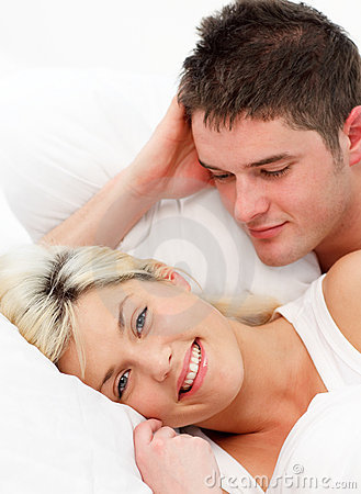 Smiling girl lying with her boyfriend