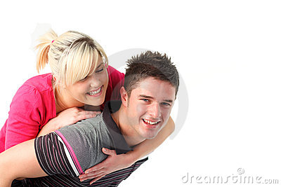 Boy giving his girlfriend piggyback ride