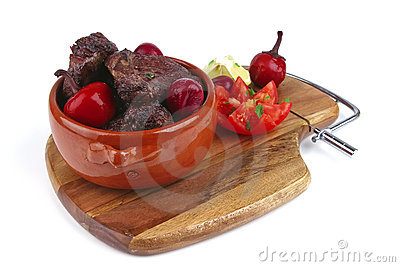 Roast meat in pot with vegetables
