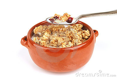 Pot full of granola with nuts