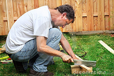 Man sawing a piece of wood