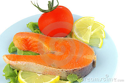 Salmon steak on blue dish