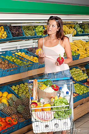 Grocery store - Young woman choosing pepper