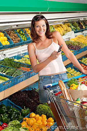 Grocery store - Young woman with mobile phone