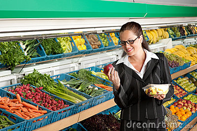 Grocery store - Business woman holding apple