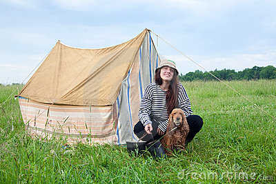 Girl with dog at camping
