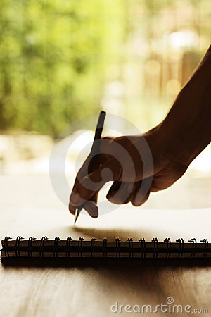 Hand writing on notepad