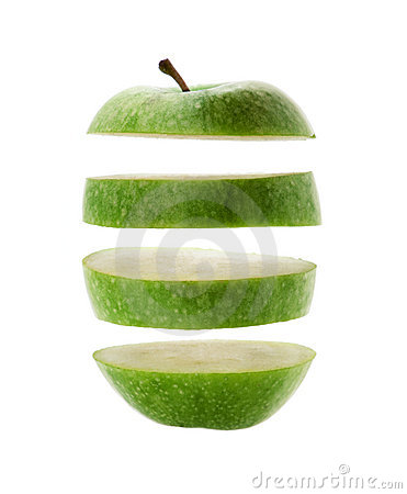 Green apple cut into slices isolated over a white