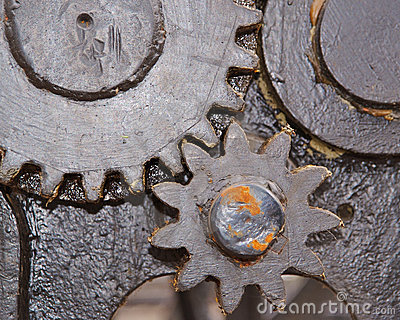 Close up of 2 greased gears