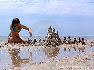 Girl with a sand castle