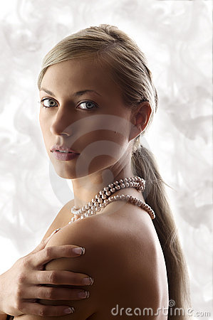Blond woman with pearl