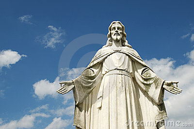 Statue of Jesus with Open Arms Blue Sky