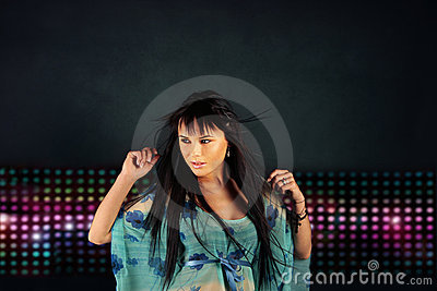 Girl dancing in the night club