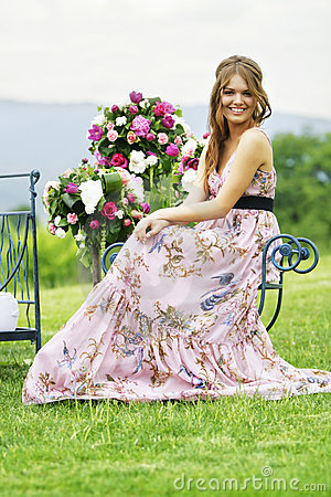 Bridesmaid and flower bouquets in nature