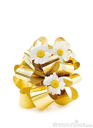 Festive golden bow and pretty flowers