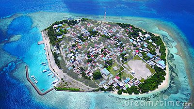 Aerial flying drone view of Rasdhoo in Maldives white sandy beach on sunny tropical paradise island with aqua