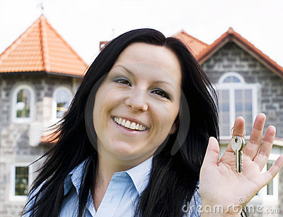 Smiling woman holding keys