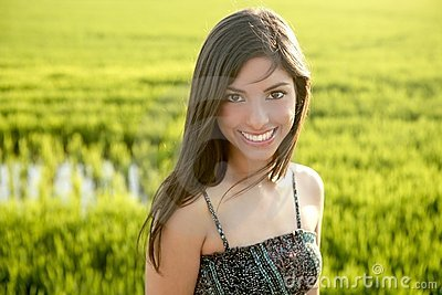 Beautiful indian woman in green rice fields