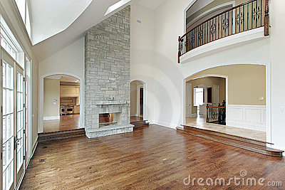 Family room with two story fireplace