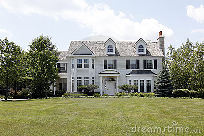 White colinal home in suburbs