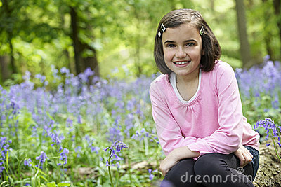 Child and bluebells