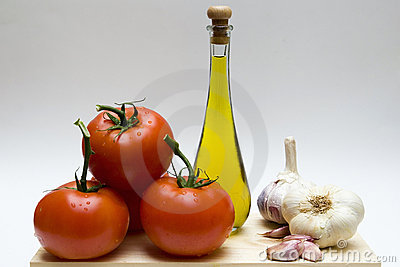Still life with garlic, oil and tomatoes