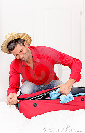 Luggaging packing man at home