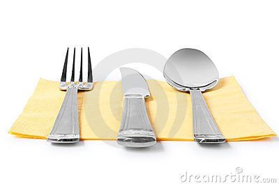 Fork, knife and spoon on table-napkin