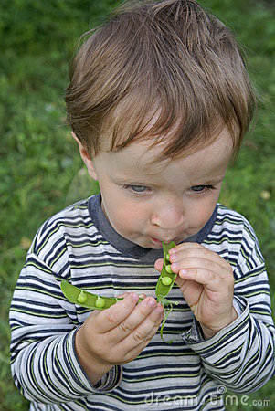 Boy eating peas