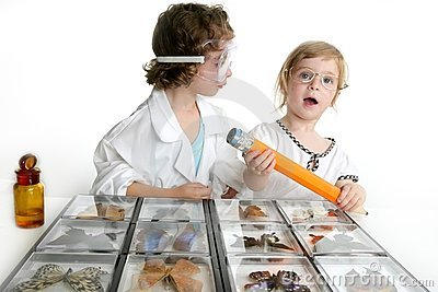 Naturalist little girls with butterfly collection