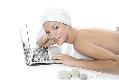 Beautiful woman in spa working with laptop