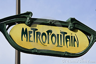 Classic yellow Paris Metro sign