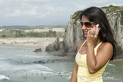 Woman calling on the beach