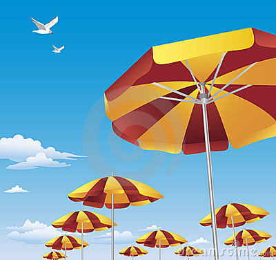Colorful beach umbrellas against blue sky
