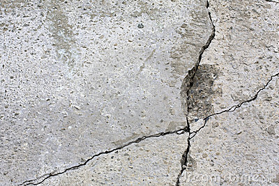 Grey wall with cracks.