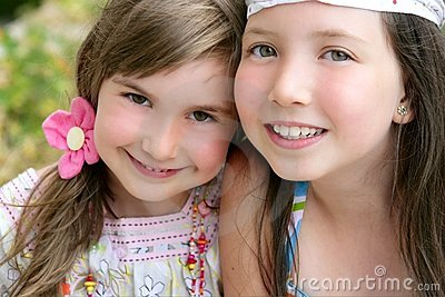 Closeup portrait of two little girl sisters