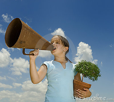 Girl with megaphone and small tree