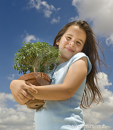 Girl holding small tree