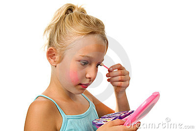 Little blonde girl is playing with make-up
