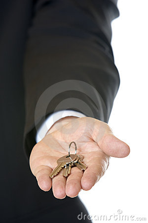Businessman holding key in hand