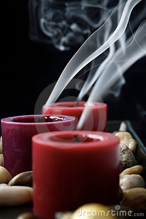 Extinguished candles in the dark.