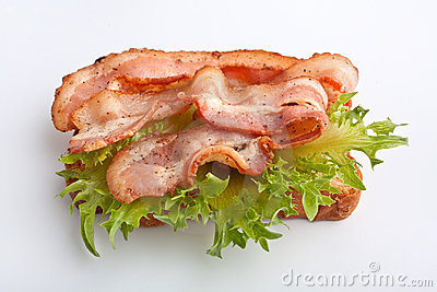 Hot sandwich with fried bacon and lettuce