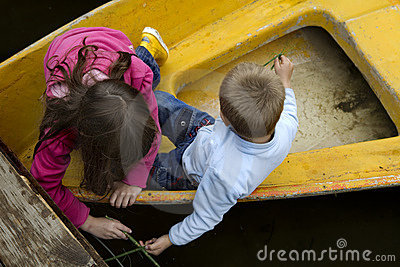 Friendship. kids playing in boat
