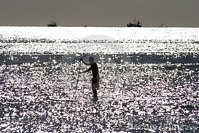 Paddleboarder silhouette