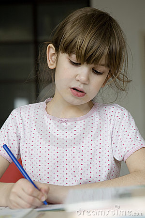 Girl seven years old doing homework