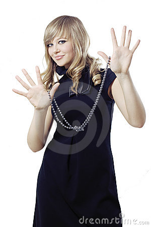 Blond girl holding necklace