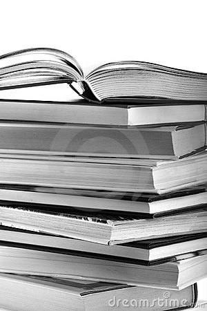 Open book on top of book stack isolated on white b