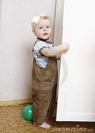 Blond boy playing in room