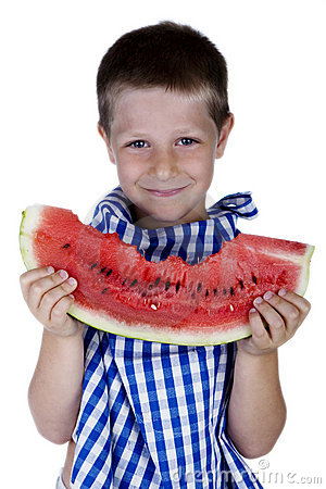 Cute smiling child holding a watermelon slice